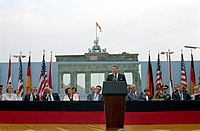 Ronald Reagan at the Brandenburg Gate challenges Soviet premier Mikhail Gorbachev to tear down the Berlin Wall in 1987, shortly before the end of the Cold War.