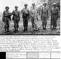 General Douglas MacArthur meeting Navajo, Pima, Pawnee and other Native American troops. Navajo served as code talkers for the military in the Pacific. The code they made, although cryptologically very simple, was never cracked by the Japanese.