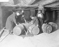 Prohibition agents destroying barrels of alcohol in Chicago, 1921.