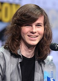 Chandler Riggs portrays Carl Grimes in the television adaptation