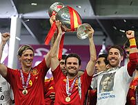 Fernando Torres (l), Juan Mata and Ramos holding the Henri Delaunay Trophy after winning the 14th European Championship