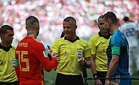 Ramos with Russia Captain Igor Akinfeev (r) and referee Björn Kuipers before the 2018 World Cup Round of 16 match at the Luzhniki Stadium in Moscow.