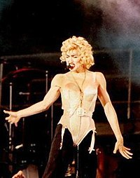 "Madonna using the ""Madonna mic"" during the 1990 Blond Ambition World Tour. She was one of the earliest adopters of hands-free headsets."
