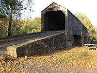 Bucks County is home to a number of covered bridges, 10 of which are still open to highway traffic and two others (situated in parks) are open to non-vehicular traffic. Shown here is the Schofield Ford Covered Bridge over the Neshaminy Creek in Tyler State Park.