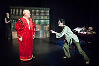 Caliban rants at Prospero while Ariel looks on, in a 2014 production by OVO theatre company, St Albans, UK