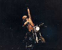 Rob Halford in 1988. One of Priest's trademark stage stunts was to have Halford ride a motorbike on stage.