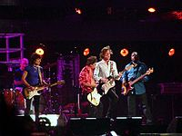 """The Oxford Dictionary of Music states that the term """"pop"""" refers to music performed by such artists as the Rolling Stones (pictured here in a 2006 performance)."""