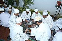 """A """"Thaal"""" in which people sit together with legs folded to eat and it is kept on the floor"""