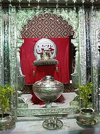 Sabeel (water-outlet with earthen pots) made up of Silver erected on the corner of Badri Mohalla every year 2 days before the day of 'Aashuraa