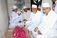 The place covered with flowers is the flattened grave of 29th 'Alavi Da'i Saiyedna 'Ali saheb - 1435 AH/2014 AD