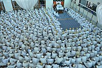 Alavi Bohras in the mosque in front of their da'i listening to the lecture involving the holy Pledge