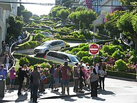 """Lombard Street is a popular tourist destination in San Francisco, known for its """"crookedness""""."""