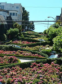 Cars navigate Lombard Street to descend Russian Hill.