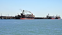 Cargo ships at the Port of Gladstone, Queensland's largest commodity seaport