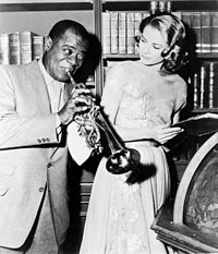 Armstrong entertains Grace Kelly on the set of High Society in 1956.