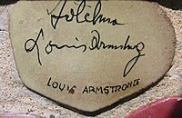 Autograph of Armstrong on the muretto of Alassio