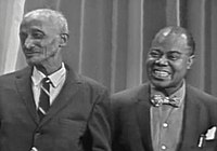 Armstrong with his first trumpet instructor, Peter Davis, in 1965