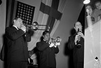 With Jack Teagarden (left) and Barney Bigard (right), Armstrong plays the trumpet in Helsinki, Finland, October 1949