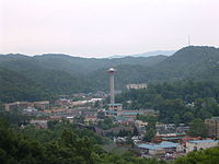 The resort city of Gatlinburg borders Great Smoky Mountains National Park, which is the most visited national park in the United States as of 2019.