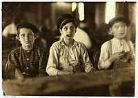 Child labor at a cigar factory, 1909. Photo by Lewis Hine.