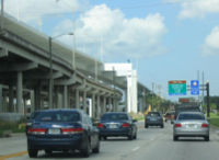The Lee Roy Selmon Crosstown Expressway features a section that is elevated over parts of the downtown area and part of the Port of Tampa. With the even taller bridge carrying the Reversible Express Lanes of the expressway.