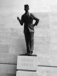 "Statue of George Orwell outside Broadcasting House, headquarters of the BBC. A defence of free speech in an open society, the wall behind the statue is inscribed with the words ""If liberty means anything at all, it means the right to tell people what they do not want to hear"", words from George Orwell's proposed preface to Animal Farm."