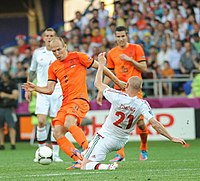 Dutch star football players Arjen Robben and Robin van Persie during a game with the Netherlands against Denmark at Euro 2012