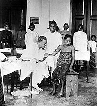 A Dutch doctor vaccinating Indonesian patients