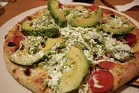 California club pizza with avocados and tomatoes.