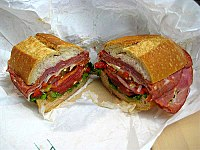 A submarine sandwich, which includes a variety of Italian luncheon meats.