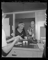 Marilyn Monroe signing divorce papers with celebrity attorney Jerry Giesler