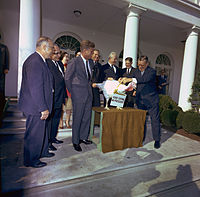 """John F. Kennedy unofficially spares a turkey on November 19, 1963. The practice of """"pardoning"""" turkeys in this manner became a permanent tradition in 1989."""