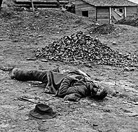 """Confederate artilleryman killed during the final Union assault against the trenches at Petersburg. Photo by Thomas C. Roche, April 3, 1865.<ref>Frassanito, p. 360.</ref><ref>See website Petersburg Project on location of Many of the Roche photographs at Petersburg April 1865</ref> Although prints of this picture list it as being taken at Ft Mahone, historians at the """"Petersburg Project"""" believe it was taken at Confederate Battery 25<ref>Dead Artilleryman comments Petersburg Project</ref>"""