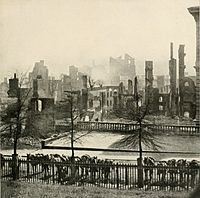 Smoke is still rising from the ruins of Richmond, Virginia after surrendering on April 3, 1865 following the Union victory at the Siege of Petersburg. Union cavalry mounts with carbines visible are hitched in the foreground.