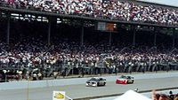 Jeff Gordon (#24) chasing down Rick Mast (#1) for the lead early in the race.