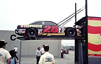 The #28 Robert Yates Racing car being unloaded from the transporter in Gasoline Alley.