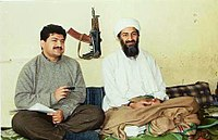 Pakistani journalist Hamid Mir interviewing Osama bin Laden in 1997. The AKS-74U in the background is a symbol of the mujadin's victory over the Soviets, since these weapons were captured from Spetsnaz forces.