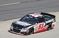 Smith driving the No. 51 during the 2013 STP Gas Booster 500