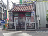 A shrine for Tudigong, a Taoist earth deity, in Kaohsiung, Taiwan; It is an example of a less garish swallowtail roof.