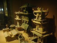 Models of watchtowers and other buildings made during the Eastern Han Dynasty (AD 25–220); while these models were made of ceramics, the real versions were made of easily perishable wood and have not survived.