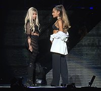 Minaj (left) performing with Ariana Grande at the T-Mobile Arena Grand Opening in 2016