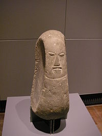 A stone carving of a Hawaiian deity, housed at a German museum