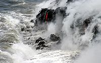 Pāhoehoe (smooth lava) spills into the Ocean, forming new rock.
