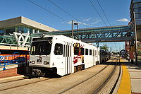 The Baltimore Light RailLink provides service to Baltimore–Washington International Thurgood Marshall Airport and the Baltimore area. Here, a train stops at Convention Center station, just west of the Baltimore Convention Center on Pratt Street.