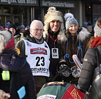 Lisa Murkowski and Verne Martell pose with Jeff King during the ceremonial start of the 2019 Iditarod.