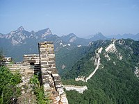 A more rural portion of the Great Wall that stretches throughout the mountains, here seen in slight disrepair