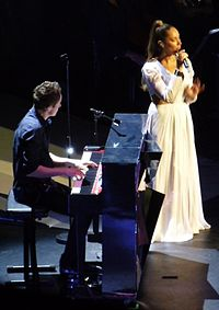 """Lewis performing a cover of """"Locked Out of Heaven"""" at the Royal Albert Hall, London on the Glassheart Tour, May 2013"""