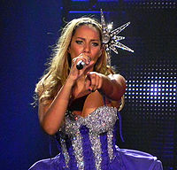 Lewis performing on The Labyrinth tour in 2010