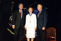 President Bill Clinton awards the Presidential Medal of Freedom to Rosalynn and Jimmy Carter at the Carter Center, 1999