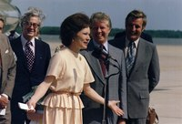 Rosalynn Carter, Jimmy Carter and Vice President Walter Mondale at a ceremony welcoming Mrs. Carter back from her Latin American trip, June 12, 1977